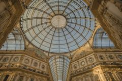 Crystal dome of Vittorio Emauele Gallery. View from inside of the top of Vittorio Emanuele Gallery in Milan, Italy, illuminated by the golden light in a royalty free stock photography