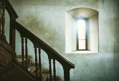 View from inside a wooden staircase. Next to a window Royalty Free Stock Image