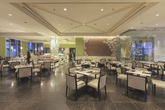 View Interior of a hotel restaurant at Miracle Grand Convention Royalty Free Stock Photo