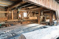 View of an traditional old saw mill with old machines and tools. A view of the interior of an old traditional saw mill with old machines and tools royalty free stock photo