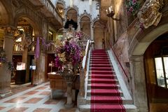 View of the interior staircase and high arches at the Danieli Hotel formerly Palazzo Dandolo, decorated for the Venice Carnival Royalty Free Stock Images