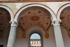 Walls, columns and arcades of the ancient medieval fortress Rocchetta inside the Sforza castle in Milan. stock photography