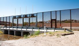 Section of international border wall in El Paso stock images