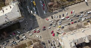 View of intersection of streets in Kiev with cars, taxis, bus and people from above in 4K. Overhead view of intersection of streets in Kiev with cars, taxis, bus stock footage