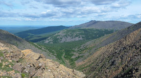 View of the Iov ravine and Serebryanskiy Stone mount, Russia. Northern Ural Mountains, View from the Iov plateau to the Iov ravine, valley of Poludnevaya river Royalty Free Stock Image