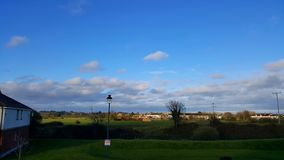 View of an Irish small town with a blue sky and white clouds Royalty Free Stock Photo
