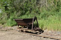 View of iron mine cart on rails Stock Photos