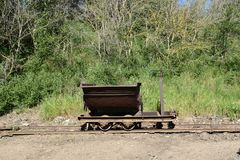 View of iron mine cart on rails Royalty Free Stock Photos