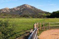 View of Iron Mountain in Poway, California. With wooden fence on a hiking trail stock images