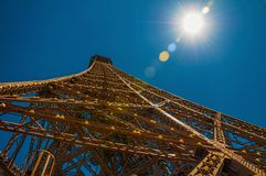 View of the iron structure from the top of Eiffel Tower with sunshine in Paris. stock image