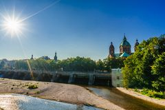 View on Isar and Sankt Lukas church in Munich. Bavaria, Germany royalty free stock images