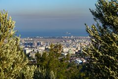 View of Turkish city from a hill. View of Iskanderun from a hill with trees and blue sky Royalty Free Stock Photo