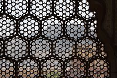 View through islamic wall with star pattern in India royalty free stock images