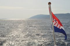 Croatian national flag flying at windy day Stock Image