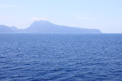 View of the island of Capri from the Tyrrhenian Sea in clear weather. Italy. Stock Photo