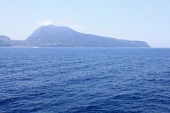 View of the island of Capri from the Tyrrhenian Sea in clear weather. Italy. Stock Photos