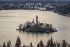 View of island with church in the middle of Lake Bled Royalty Free Stock Images