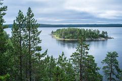 View of the island from the cliff through the pines. White Sea, Russia stock photos