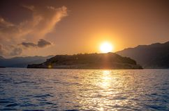 View of the island of Spinalonga with calm sea. Here were isolated lepers, humans with the Hansen`s desease, gulf of Elounda. View of the island of Spinalonga Royalty Free Stock Image