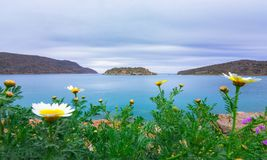 View of the island of Spinalonga with calm sea. Here were isolated lepers, humans with the Hansen`s desease, gulf of Elounda. View of the island of Spinalonga Royalty Free Stock Photos