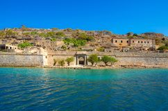 View of the island of Spinalonga with calm sea. Here were  lepers, humans with the Hansen`s desease, gulf of Elounda. View of the island of Spinalonga with calm Stock Image