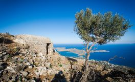 View of the island of Spinalonga with calm sea. Here were  lepers, humans with the Hansen`s desease, gulf of Elounda. Panoramic view of the gulf of Elounda with Stock Photography
