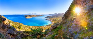 View of the island of Spinalonga with calm sea. Here were  lepers, humans with the Hansen`s desease, gulf of Elounda. Panoramic view of the gulf of Elounda with Royalty Free Stock Photography