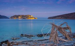 View of the island of Spinalonga at night with nice clouds and calm sea. Here were  lepers. View of the island of Spinalonga at night with nice clouds and calm Royalty Free Stock Photography