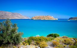 View of the island of Spinalonga at sunset with nice clouds and calm sea. Spinalonga Crete is an island where were  lepers, humans with the Hansen`s desease Royalty Free Stock Photography