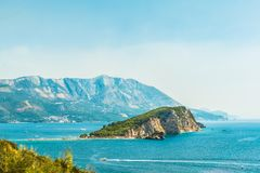 View of the island of St. Nicholas in the Gulf of the Adriatic Sea near the town of Budva, the famous tourist resort of Montenegro Royalty Free Stock Photo