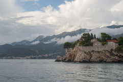 View of the Island of St. Stephen from the sea. Beach close to Sveti Stefan, Montenegro Royalty Free Stock Photography