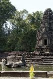 View of the island temple Preah Neak Pean with fountain statues. Scene around the Angkor Archaeological Park. The site contains the remains of the different Stock Photography