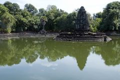 View of the island temple Preah Neak Poan. Scene around the Angkor Archaeological Park. The site contains the remains of the different capitals of the Khmer Stock Photography