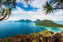 View of the island. Views of the islands from the top of an island with tree branches Stock Image