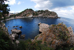 A view from Isola Bella island on the village Taormina Royalty Free Stock Photography