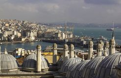 View on Istanbul acros bosphorus. Towers and domes, strait with sailing ships and colorful city stock photos