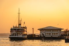 View from Istanbul city with passenger ship, port and seagulls at sunset background. Turkey royalty free stock photo