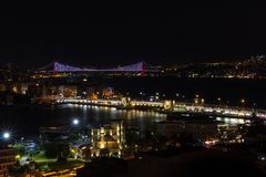 View of Istanbul at night with Bosphorus Bridge. July 15 Martyr Bridge  in the view Royalty Free Stock Images