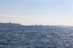 View of Istanbul Skyline and Maiden Tower in the Distance royalty free stock images