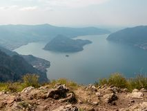 View of Italian Alpine Lake Iseo and the near Mountains, the lake Shore and island of Monte Isola with the small village royalty free stock photo