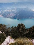 View of Italian Alpine Lake and the near Mountains, the lake Shore and island of Monte Isola with the small village stock photography