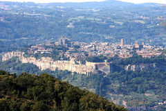 View at Italian city Orvieto, Umbria. Orvieto, a city in Italian southwestern Umbria, is situated on the flat summit of a large butte of volcanic tuff, rising Royalty Free Stock Photo