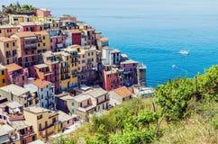 View of italian Manarola town in Cinque Terre. Beautiful summertime view of colorful Manarola town in Cinque Terre, Liguria, Italy royalty free stock photos