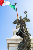 View of Italian national flag in front of Altare della Patria Stock Photography