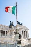 View of Italian national flag in front of Altare della Patria Stock Images