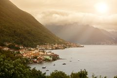 View of italian village on Como lake in sunlight Royalty Free Stock Image