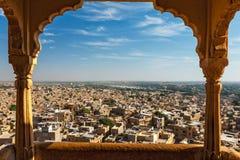 View of Jaisalmer city from Jaisalmer fort, Rajasthan, India. View of Jaisalmer city from Jaisalmer fort through arch. Jaisalmer, Rajasthan, India royalty free stock image