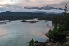 A view of jasper and the Athabasca River as it weaves its way through the Jasper National Park, Canada. On a cloudy day. A view of jasper and the Athabasca River royalty free stock photos
