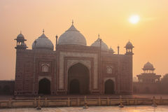 View of Jawab at sunrise in Taj Mahal complex, Agra, Uttar Prade. Sh, India. Jawab was built for symmetry and probably used as guest accomodation Royalty Free Stock Image