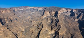 View of Jebel Shams in Oman. View of the grand canyon of middle east at the Jebel Shams mountain in Oman royalty free stock photo
